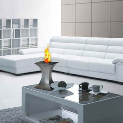 Concave Tabletop Bio Ethanol Fireplace by PureFlame - Concave, with a styling that's just that, is ideal for creating emotional decor. Providing a 360 degree, open view of the dancing flame, Concave provides comforting warmth in a small space or patio. This fireplace offers an eco-friendly flame that is odorless. Bio Ethanol, an alternative fuel source produced from plants, only emits water vapor and carbon dioxide into the air. Although ethanol fireplaces aren't intended for use as a primary heat source, the Concave model produces heat that will change the ambient temperature of a small area. An unobstructed view is offered through the open flame of this piece, and it may not be suitable for use in the proximity of children. Appropriate for any space, indoors or out, Concave is offered in brushed stainless steel.