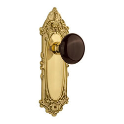 Nostalgic - Nostalgic Single Dummy-Victorian Plate-Brown Porcelain Knob-Polished Brass - The Victorian Plate in polished brass, with its distinct curvilinear embellishment, is unmistakably old world vogue. Adding our rich, Brown Porcelain knob only serves to compliment the warm, earthen hues in your home. All Nostalgic Warehouse knobs are mounted on a solid (not plated) forged brass base for durability and beauty.