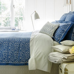 Evelyn Duvet - This lovely spot design in dramatic petrol blue has a real wow factor. The luxurious sateen weave has an incredibly smooth handle and the grosgrain trim adds a touch of luxury. 300 thread count, 100% Cotton Sateen.  Button Closure.