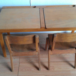 French Midcentury Modern Double Children's School Desk by Herman Schwartz - Did you have a desk like this at school? I did — inkwell and all. While I'm sure my boys wouldn't appreciate the sentimental benefits, I'm sure they would love the idea of a desk you can stash things in.