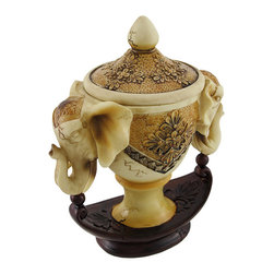 Ivory Colored Twin Elephant Head Trinket Box - Add a decorative accent to shelves, bookcases, tables, or desks in your home or office with this trinket box. Made of cold cast resin, it measures 6 3/4 inches long, 8 1/4 inches tall, and 4 inches wide. It is quite detailed and has a lovely distressed finish, giving the piece an antique appearance. It is great for storing small keepsakes, candies, or mints, and it is sure to be admired.