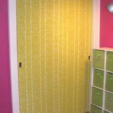 Eclectic  designsponge- wallpaper on closet doors