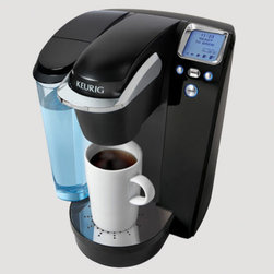 "Keurig - K75 Coffee Maker - Features: -Coffee maker.-Brews in under 1 minute.-Quiet brew technology.-Fully Programmable.-Makes up to 10 cups before refilling.-Energy saving mode auto On/Off.-Adjustable temperature.-Digital clock.-Water reservoir.-Distressed: No.-Product Type: Single cup brewer.-Collection: K-Cup.-Powder Coated Finish: Yes.-Gloss Finish: Yes.-Material: Plastic, Stainless Steel.-Hardware Material: Plastic,Stainless steel.-Number of Items Included: 4.-Pieces Included: Brewer, 12 count K-Cup® variety box, Water Filter Handle, Charcoal Water Filter.-Rust Resistant: Yes.-Stain Resistant: Yes.-Odor Resistant: Yes.-Scratch Resistant: Yes.-Warp Resistant: Yes.-Shatterproof: Yes.-Brewing Temperature: 192 degrees F.-Adjustable Temperature: Yes.-Adjustable Water Pressure: No.-Brew Head Style: Single-Serve.-Filter Type: Use: K-Cup packs.-Filter Basket Material: Plastic.-Water Window: Yes.-Maximum Water Capacity: 72 oz.-Removable Water Tank: Yes.-Water Filter: Yes -Charcoal Water Filter: Yes..-Scale: No.-Drip Tray: Yes -Removable Drip Tray: Yes..-Lighted On/Off Switch: Yes.-Brew Complete Indicator: Yes.-LCD Display: Yes.-Cup Storage: No.-Quiet Brew: Yes.-Hot Water Dispenser: No.-Milk Storage: No.-Cord Storage: No.-K-Cup Compatible: Yes.-Grinder Included: No.-Splash Guard: No.-Pause Feature: No.-Vacation Switch: Yes.-Personal Size: Yes.-Auto Shutoff: Yes.-Foam/Froth: No.-Clock: Yes.-Timer: No.-Programmable: Yes.-High Altitude: Yes.-Energy Saver Mode: Yes.-Wattage: 1500 W.-Voltage: 120 VAC.-Amperes: 120V.-Nonstick: No.-Dishwasher Safe: No.-Microwave Safe: No.-Installation: Plug in power source and fill water reservoir..-Warmer Plate: No.-Carafe Included: No.-Cups or Mugs Included: No.-Scoop Included: No.-Commercial Use: No.Specifications: -BPA Free: Yes.-UL Listed: Yes.-cUL Listed: Yes.-ETL Certified: Yes.-cETL Certified: Yes.Dimensions: -Overall Product Weight: 17.4 lbs.-Overall Height - Top to Bottom: 13"".-Overall Width - Side to Side: 10.3"".-Overall Depth - Front to Back: 13.8"".-Cord Length: 36"".-Filter Height: 2.5"".Assembly: -Assembly Required: Yes.-Tools Needed: No tools necessary.-Additional Parts Required: No."