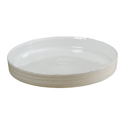 Montes Doggett - Hand-thrown Quiche Baker - This beautifully handmade ceramic dish is a real workhorse. Since it's oven safe, you can use it to bake a tart and then serve it. And when you're done, simply rinse and place it in the dishwasher for an easy cleanup job.