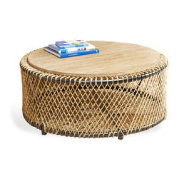Saranda Beach Style Wood Rope Round Coffee Table - Listen closely and hear the waves crashing on the shore. This natural, weathered rope detailing and distressed wood evoke casual, coastal ease. The airy, open design feels simple and elegant as a coffee or side table.