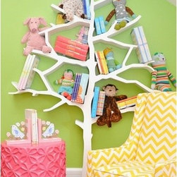 Tree Bookcase - I would have loved this in my room as a child! Tree branches provide the storage, and the entire design is a whimsical approach to saving space in a kid's room.