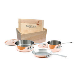 Mauviel M'Heritage M'150s 5 Piece Copper Cookware Set W/ Wooden Crate - The Mauviel M'Heritage 5 piece cookware set allows you to cook with unsurpassed heat conductivity and control thanks to it's 90% copper  10% stainless steel construction.  The M'150s collection features classic cast iron handles  stainless rivets  a polished copper exterior  and an 18/10 stainless interior.  The cookware has a thickness of 1.5 mm  and the copper exterior allows for superior heat conduction and control.  The M'Heritage collection represents the total experience and heritage of Mauviel 1830.  This set comes packaged in a traditional and attractive wood crate  a great touch for gift presentation.  Set includes      1.9 qt Saucepan (6410.17)   1.9 qt Saucepan Lid   3.2 qt Saute Pan (6411.25)   3.2 qt Saute Pan Lid   10.2 in Fry pan     Product Features      Bilaminated copper stainless steel - 90% copper and 10% 18/10 stainless steel   Copper cookware heats more evenly and much faster than other metals  and offers superior cooking control   1.5 mm thickness   18/10 stainless steel interior preserves the taste and nutritional qualities of foods and is easy to clean   Mauviel M'150s cookware can be used on gas  electric  halogen stovetops  and in the oven. It can also be used on induction stovetops with Mauviel's induction stove top interface disc (sold separately)   Mauviel cookware is guaranteed for life against any manufacturing defects (Warranty not valid for commercial use)   Made in France
