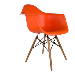 """Montmartre Arm Chair in Orange - Some designs were ahead of their time. Considered the chair of tomorrow both for its design and its innovative single-mold manufacturing process, the Montmarte Arm Chair is inspired by one of the most iconic mid-century furniture designs. Created in the spirit of economy and affordability, its unique shape was designed to spread the sitter's weight and pressure evenly. The deep seat and waterfall edge provide additional comfort as the design shapes itself around the body's curves, while its ashwood dowel legs add a classic touch. If you've done away with formality in your home, the Montmarte Arm Chair is that one piece of furniture that exemplifies the """"less is more"""" ethos. It's the ultimate seat that goes well in a variety of different settings: as a home office chair, an entryway slipper seat, or a statement piece in the living room."""