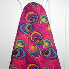Peacock Feathers Ironing Board Cover - Make your ironing board something to show off, rather than hide! Etsy seller GaranceCouture has an amazing shop chock full of unique ironing board covers. This crafty sewer uses a 100% cotton quilting fabric that's completely encased in matching bias tape. It's completely machine washable, and will fit any standard sized ironing board.