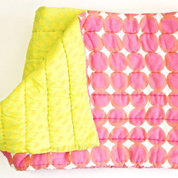 "See Design - Twin Quilt, Egg Pink/Orange - These quilts have a different, complimentary pattern on each side. Available in Twin and Queen sizes. The quilts are encased in very soft 100% cotton voile, filled with 100% cotton batting and hand quilted. The Twin size measures 70""x90""."