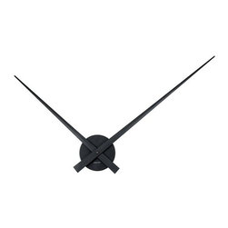 "Floating Hands Clock - black - Nothing is quite as minimalistic as our Floating Hands clock. The large hands and absence of hour markers make this clock a simple yet contemporary piece of functional art. The clock is made of a thin stainless steel painted black and spans a diameter of 30"". The clock is powered by one ""AA"" battery (not included)."