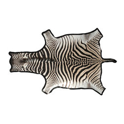 Zebra Skin Rug - When in doubt, a zebra hide is the classic way to incorporate the print into any design. Over a seagrass rug or hardwood floor, it is the flooring statement.