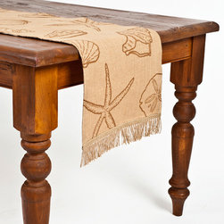 ecoaccents - ecoaccents Brown Shell Burlap Table Runner - ecoaccents Brown Shell Burlap Table RunnerAdd instant charm to your dining table with the environmentally friendly Brown Shell Burlap Table Runner from ecoaccents. Crafted from 100% biodegradable burlap, this all-natural beauty feels like linen and is finished with cut-jute trim. Its playful seashell pattern is beachy and relaxed. Drape it down the middle of your table for a casual look in an coastal home, or use it as a light-hearted touch in a rustic dining room.Linen-like burlap with natural cotton lining and cut-jute trimMade in India