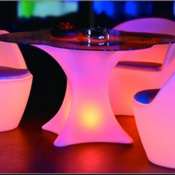 Outdoor LED Lights - Took the photos myself. Glowing table and Chairs.  LED light products  Nine Hours of continuous Use, changes colors by remote control. Prices vary based on size, for more info contact us at Jaavanpatio.com
