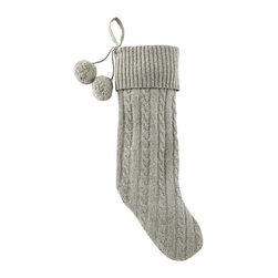 Gray Cable-Knit Stocking - For a truly lived-in look, I prefer non-matching stockings. Mix colors, patterns and textures for modern imperfection. This traditional knit stocking is adorned with playful pom-poms.