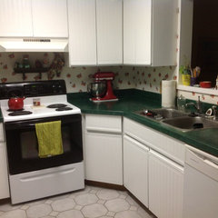 I applied bead board wall paper to the center of all of the cupboards and drawer