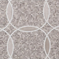 Cape Cod Collection Lattice Circle Mosaic Tile - We designed this exclusive circular marble mosaic and waterjet interlocking pattern so that when the tiles are placed together and grouted they fit seamlessly together. You cannot see where one tile begins and the next ends. Each tile is both polished and honed to create luxurious definition and texture on your wall or floor. It can be used for both commercial and residential settings.  We recommend it for kitchen backsplashes, bathroom floors and walls as well as wet areas (i.e. shower floors and walls).  The mesh backing not only simplifies installation, it also allows the tiles to bend and seperate.  We recommend using an unsanded beige grout. Chip