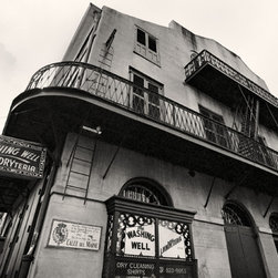 The Andy Moine Company LLC - The Washing Well Bourbon St French Quarter New Orleans Black & White Photography - Black and White Fine Art Photography captured with 35MM Ilford Film and reproduced in limited editions on Canvas OR Brushed Aluminum. This is a beautiful composition of the Washing Well Laundryteria on Bourbon Street in the historic French Quarter of New Orleans, Louisiana.