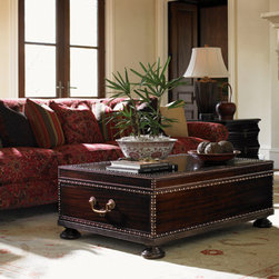 Lexington Home Brands - Sunset Cay Cocktail Table - With a stylish pattern of decorative nailhead trim outlining the perimeter and exquisite porter's handles on the ends, the look of antique brass against the rich Mahogany finish is exceptional. Two drawers for storage.