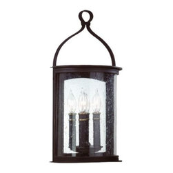 Troy Lighting - Scarsdale Outdoor Wall Mount by Troy Lighting - It was a dark and stormy night.... But, with durable hand-forged iron construction, the Troy Lighting Scarsdale Outdoor Wall Mount is always there to light the way to safety. Set flush against the wall, a half-cylinder of Heritage seeded glass encloses the light source and diffuses gleaming, refracted light, which is magnified by the mirrored wall plate. Available in three sizes. Troy Lighting, headquartered in California, designs and manufactures indoor and outdoor lighting fixtures, utilizing hand-forged iron and hand-applied finishes to create quality products with high-style appeal.