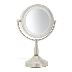 Jerdon LT856N 8.5-Inch Tabletop Two-Sided Swivel Halo Lighted Vanity Mirror - The Jerdon LT856N 8.5-Inch Tabletop Two-Sided Swivel Halo Lighted Vanity Mirror is an ideal bathroom and makeup accessory that provides lighting and magnification options to display a clean, bright reflection whenever you need it. This fog free, two-sided circular mirror has a 8.5-inch diameter that features a smooth 360-degree swivel design and provides 1x and 7x magnification options to make sure every detail of your hair and makeup are in place. The halo light design around the perimeter of the mirror and smooth rotation provide a dynamic point of view. This item can use the JPT25W replacement bulb (sold separately). An on/off rotary knob on the side base will activate the halo lighting when you need it. The LT856N stands 16-inches high, stands upright on countertops, vanities and tables and has an attractive matte nickel finish that protects against moisture and condensation. The Jerdon LT856N 8.5-Inch Tabletop Two-Sided Swivel Halo Lighted Vanity Mirror comes with a 1-year limited warranty that protects against any defects due to faulty material or workmanship. The Jerdon Style company has earned a reputation for excellence in the beauty industry with its broad range of quality cosmetic mirrors (including vanity, lighted and wall mount mirrors), hair dryers and other styling appliances. Since 1977, the Jerdon brand has been a leading provider to the finest homes, hotels, resorts, cruise ships and spas worldwide. The company continues to build its position in the market by both improving its existing line with the latest technology, developing new products and expanding its offerings to meet the growing needs of its customers.
