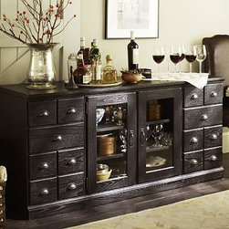 """Printer's Large Buffet Artisanal Black stain - Create a grand station for entertaining with the new large buffet from our Printer's Collection. Pattered after the handsome functionality of vintage typesetter's cabinets, it's generously scaled to provide ample space for all your dining essentials. 64"""" wide x 20"""" deep x 30"""" high The Large Entertaining Buffet includes one glass door double pedestal, two cabinet pedestals, and one quadruple top. Handcrafted with a kiln-dried wood frame. The glass door double pedestal has two adjustable shelves. The cabinet pedestal has a bluff-cut door and two removable shelves. Finished by hand in our exclusive Tuscan Chestnut or Artisanal Black stain. View our {{link path='pages/popups/fb-home-office.html' class='popup' width='480' height='300'}}Furniture Brochure{{/link}}."""
