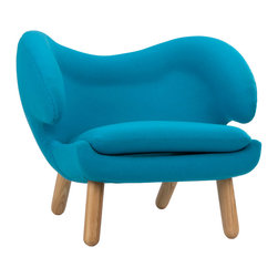 "Winged Lounge Chair in Blue - From the pelican-shaped ""wings"" to its solid walnut legs, this lounge chair should be a staple in every modern home. Inspired by an iconic Danish mid-century design, the chair's roomy, high-density foam seat and oversized back means repartee with guests can last into the wee hours of the night. Make it your conversation pit's statement piece and watch guests sink into the comfort of the chair's form."