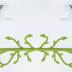 Florafil - Bring nature into the office. Even if it is in the form of a rubber cord cover, the sinuous and meandering form of a vine is an unexpected and cheerful addition to any workspace.