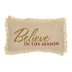 """VHC Brands - Cream Burlap Believe In The Season Pillow - This pillow measures 7""""x13"""", front features the stenciled saying """"Believe in the Season"""". Stencil is red & gold on a creme colored pillow. This pillow is 100% cotton woven burlap and is accented with fringe. Spot clean with a damp cloth."""