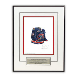 """Heritage Sports Art - Original art of the NHL 2000-01 Columbus Blue Jackets jersey - This beautifully framed piece features an original piece of watercolor artwork glass-framed in a timeless thin black metal frame with a double mat. The outer dimensions of the framed piece are approximately 13.5"""" wide x 17.5"""" high, although the exact size will vary according to the size of the original piece of art. At the core of the framed piece is the actual piece of original artwork as painted by the artist on textured 100% rag, water-marked watercolor paper. In many cases the original artwork has handwritten notes in pencil from the artist. Simply put, this is beautiful, one-of-a-kind artwork. The outer mat is a clean white, textured acid-free mat with an inset decorative black v-groove, while the inner mat is a complimentary colored acid-free mat reflecting one of the team's primary colors. The image of this framed piece shows the mat color that we use (Medium Blue). Beneath the artwork is a silver plate with black text describing the original artwork. The text for this piece will read: This original, one-of-a-kind watercolor painting of the 2000-01 Columbus Blue Jackets uniform is the original artwork that was used in the creation of thousands of Columbus Blue Jackets products that have been sold across North America. This original piece of art was painted by artist Nola McConnan for Maple Leaf Productions Ltd. The piece is framed with an extremely high quality framing glass. We have used this glass style for many years with excellent results. We package every piece very carefully in a double layer of bubble wrap and a rigid double-wall cardboard package to avoid breakage at any point during the shipping process, but if damage does occur, we will gladly repair, replace or refund. Please note that all of our products come with a 90 day 100% satisfaction guarantee. If you have any questions, at any time, about the actual artwork or about any of the artist's handwritten notes on"""