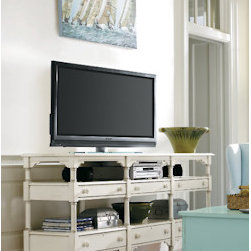 Stanley-Coastal Living - Reunion Console - Display your flat screen TV with pride atop the Reunion Console from Stanley. Its coastal-cottage design is highlighted by clean lines, turned tapered legs, and simple wooden knobs; while an airy sand dollar finish coats the hardwood solids of this well-made console. 6 shelves and 6 drawers offer excellent storage and display space for electronics and collectibles. Features like corner molding and adjustable shelving give this piece function and style, making it the perfect addition to any home!