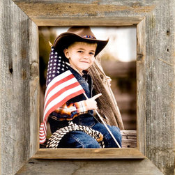 MyBarnwoodFrames - 10x20 Cowboy Picture Frame, 3 inch Wide, Western Rustic Series - Cowboy  Picture  Frame  from  the  Heart  of  America          Your  Cowboy  Picture  Frame  won't  get  any  more  authentic  than  this.   Built  from  reclaimed  barnwood  harvested  in  the  heart of  the  American  West,  these  handmade  rustic  frames  will  complement  any  country  rustic  decor.                    Frame  is  crafted  from  authentic  barnwood              One  10x20  photo  opening              Final  product  approximately  16x26              Frame  width:   3              Flat  outer  frame  is  2-1/2  inches  wide,  interior  casing  for  the  frame  is  1/2-3/4  inches  wide              Depth  of  interior  shadowbox  is  approximately  1/2  inch.              Includes  glass,  backing  and  hanging  hardware              The  flat outer  edge  of  the  Cowboy  Picture  frame  is  2  1/2  inches  wide  with  a  1/2  inch  interior  casing,  making  the  entire  frame  width  just  over  3  inches  wide.   This  generous  frame  width  highlights  the  beautiful  textures  and  colors  of  the  natural  barnwood  without  overpowering  the  framed  subject.            This  barnwood  frame  is  appropriate  for  any  decor  that  includes  primitive  wood  (in  a  summer  cabin  or  a  cozy  ski lodge,  for  example).  Another  benefit  of  rustic  barnwood  frames  is  that  they  are  suitable  for  such  a  large  range  of  subject  matter.   Purchase  several  to  frame  your  collection  of  Nashville-themed  poster  prints,  or  create  a  collage  to  show  off  your  bird  watching  photographs.   Frame  an  embroidered  sampler  or  a Native  American  sand  painting.  The  possibilities  are  almost  limitless.           Because  of  its  shadowbox  look,  this  cowboy  picture  frame  lends  itself  to  all  kinds  of  creativity.   Remove  the  backing,  frame  a  piece  of  antique  stained  glass  and  center  it  over  a  sunny  window. 