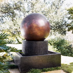 """Rotating Ball Fountain - Adding movement to the garden, the """"Rotating Ball Fountain"""" with its beautiful copper hues, will be a wonderful and artistic focal point in the garden."""