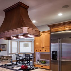 Completed Kitchens - Bella Copper Range Hood. Smooth Texture / Dark Finish with Straps and Rivets. Designed by Copper Kitchen Specialists.
