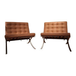 Pre-owned Ludwig Mies Van Der Rohe Barcelona Chairs - A pair of Ludwig Mies Van Der Rohe Barcelona Chairs. These two chars are absolutely like new - in perfect condition! There are no scratches or damage of any kind and all materials are first rate!     Materials: bar-stock steel frame with hand-ground and hand-buffed chrome finish; cowhide belting; aluminum rivets; Dacron wrapped high-resiliency urethane foam and fiberfill cushions; semi-aniline leather upholstery. The cushions, welting and buttons included are leather cowhide and are supported by cowhide belting straps, dyed to match the color of the chair.     The Barcelona Chair was honored with the Museum of Modern Art Award in 1977.