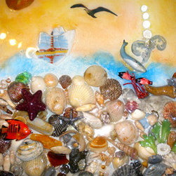 North Carolina Beach (Original) by Kathy Webster - This is my view of a walk on the beach at home in North Carolina.  The original art piece showcases various shells and other items found on the beach. For the sun there is a large sand dollar. A lighthouse hovers in the distance. On top of each work, I pour a resin over the surface to protect it. The surface becomes almost glass-like. It will be the first art you own that children and your guests will be allowed to touch.