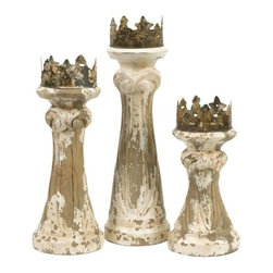 "IMAX - Feliciano Handcarved Wood Candleholders - Set of 3 - This set of three hand carved wood Feliciano candleholders mix a regal look with antiqued finishes to add character to any room. Holds pillar candles. Item Dimensions: (11.25-14.5-17.25""h x 5.25-5""w x 5.25-5"")"