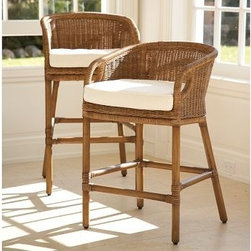 Wingate Rattan Barstool | Pottery Barn - Crafted with a kiln-dried mahogany frame and legs.