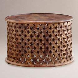 Tribal Carved Coffee Table - Global influences are going stronger than ever. This African-inspired wood table adds the texture a room needs.