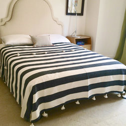 """Abanja - Tanger Bed Cover/Throw - Classic horizontal stripes lend the Tanger bed cover captivating graphic style. Accented by whimsical oversize pom-pom trim, this bedding's pattern pops in striking black and white. Queen cover: 86.6""""W x 94.5""""H; 85% cotton/15% acrylic; Stripes: 9""""W"""