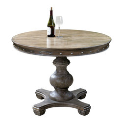 Sylvana Round Table - It may owe its inspiration to the appointments of country villas in Campania, Italy. Crafted of weathered, natural pine, the Sylvana Round features a light gray wash, carved apron, and silver nail accents that impart an heirloom aesthetic to the piece. The handsome pedestal base is fully washed in gray with rub-through distressing.