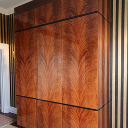 """Virginia Cabinetworks, Inc. - Curles Neck Remodel - Master Closet:  Island is Wenge and Ebony, tall closet is Sycamore & Wenge, armoir is sunburst Sycamore and high gloss black, closet piece is book matched crotch mahogany with black inlays.  Ctop is 2 1/4"""" black marble."""
