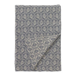 DwellStudio - Priya Throw by DwellStudio - A vintage Indian textile inspired the delicate floral pattern of the DwellStudio Priya Throw. It is an ornate pattern, with its rows of interwoven vines standing out sharply against a contrasting background (cream and flint grey, respectively, on one side; flint and cream on the other). It is made out of soft blend of lambswool and nylon. DwellStudio, founded in 1999 by Christiane Lemieux, specializes in home furnishings steeped in modern design. With a unique sense of color and a strong commitment to quality and innovation, DwellStudio continues to create its own distinctive interpretation of modern home furnishings. In the same creative spirit, the company encourages their customers to experiment with mixing various DwellStudio textile lines together.