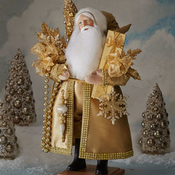 """Lynn Haney - Lynn Haney Snowflake Santa - Exclusively ours. Resplendent in golden attire and carrying golden decorations and packages, this Santa wears a silk coat bordered in rhinestones. Signed by Lynn Haney. Made of resin, fabric, and rabbit fur (China). 7""""Sq. x 21""""T. Made in the USA...."""