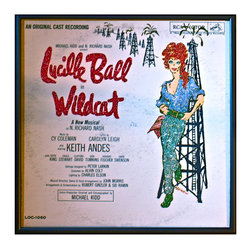 """Glittered Lucille Ball Wildcat Album - Glittered record album. Album is framed in a black 12x12"""" square frame with front and back cover and clips holding the record in place on the back. Album covers are original vintage covers."""