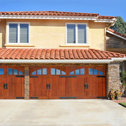 Carmel Valley Garage Door - The homeowner choose these beautiful African Mahogany doors to give their home that wow factor!
