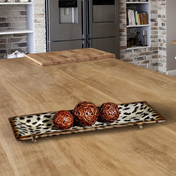Malawi Ceramic Tray - Engage your wilder side in an understated, classic way with the Malawi Ceramic Tray. A unique accessory that shows a fun, playful side while remaining elegant. Place one atop your dresser to hold your necklaces or rings or perhaps on your vanity for you to set your hairbrush or comb on. Beautiful burnished cheetah print is accentuated with a darker outline around the tray while footed knobs give the tray a little boost in height. This is a tray that works well with many tastes and styles of decor and can be reused over and over again.