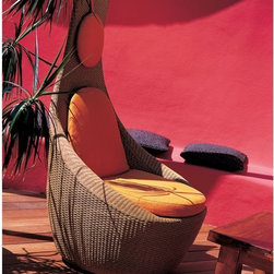 EMU Yucca Modern Outdoor Wicker Lounge Chair - This outdoor chair has a cool design that has a throwback retro feel with it's rounded base and orange cushions. It's tons of fun.