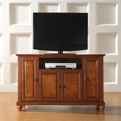 """Crosley Furniture - Cambridge 48"""" TV Stand in Classic Cherry - Beautiful Raised Panel Doors. Antique Brass Finish Hardware. Five Adjustable Shelves. Wire Management. Adjustable Levelers in Legs. Accomodates most 50"""" TV's. Solid Hardwood & Veneer Construction. 30in. H x 47.75in. W x 18in. D (98 lbs)Constructed of solid hardwood and wood veneers, this cabinet is designed for longevity. The rich, hand rubbed, multi-step Classic Cherry finish is perfect for blending with the family of furniture that is already part of your home. Antique Brass finish hardware adds a touch of style to this already beautiful cabinet. There is plenty of storage space and wire management behind the beautiful raised panel doors to hide electronic components, gaming consoles, DVDs, and other items that you would prefer to be out of sight. The 47 3/4"""" width means that this cabinet is perfect for most 50"""" TV's. Style, function, and quality make this cabinet a wise choice for your home furnishings needs, and is sure to be a part of your home for years to come."""