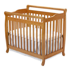 """DaVinci - Emily Mini 2-in-1 Convertible Crib - Born from the best-selling Emily crib to meet the budget of the American family. Ideal for staying at the grandparents, this Emily Mini 2-in-1 Convertible Crib is the perfect solution to conserve space. DaVinci offers an extensive array of baby furniture with a broad selection of crib styles and complementary pieces to help you create a complete nursery. The Wooden Bed Rails are a very simple and cost effective solution to transition your child's crib to a twin size bed. Crib Features: -Emily collection. -Meets and exceeds all US safety standards. -1"""" Mattress pad included. -Converts to twin-sized bed with Optional Bed Rails. -Constructed from New Zealand Radiata Pine Wood. -Linens not included. -Mattress not included. This is a NON-Drop Side crib Mattress Features: -For use with DaVinci Mini Cribs. -Non-allergenic. -Cloth binding. -Meets Federal Flammibility Standard CFR-1632. -3"""" Mattress Pad is constructed of lightweight, high-density, 100% polyester RPFB batting and has a reinforced laminated cover. -50-Coil Mattress has tempered steel, 14-gauge coils, a 9-gauge border rod for edge support, resinated polyester fiber batting padding and a reinforced, triple-laminated, wet-proof cover. Dimensions: -Crib: 38"""" H x 77"""" W x 28"""" D. -Wooden bed rails: 2.75""""H x 4.5""""W x 77""""D. -Mattress: 3-5.5"""" H x 24"""" W x 38"""" D. About New Zealand Radiata Pine Wood: Radiata Pine, better known as 'New Zealand Pine' is a softwood tree that contains many properties that make it very suitable for furniture and furniture making. It has a density equal to that of hardwoods like poplar, mahogany and oak. Its uniform density ensures a smooth and consistent texture and confers its excellent machining, painting and staining properties; there is almost no variation in color between pieces. DaVinci's pine wood originates from forests maintained by managers that enforce environmental responsibility and the conservation of forest wildlife. ***Please note th"""